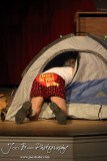 """Duane played by K.B. Bell searches a tent during the Great Bend Community Theater's final rehearsal of """"Duck Hunter Shoots Angel"""" by Mitch Albom at Crest Theater in Great Bend, Kansas on April 17, 2013. (Photo: Joey Bahr, www.joeybahr.com)"""