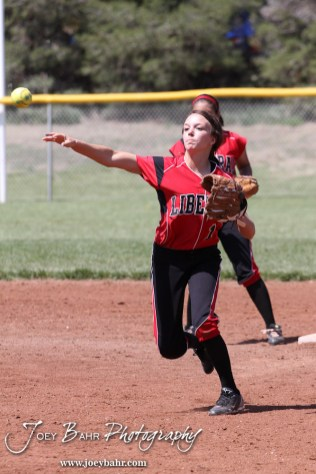 Liberal Lady Redskin Riley Hay (#1) throws a ball to First during the Liberal Lady Redskins at Great Bend Lady Panthers Softball Double Header with Great Bend winning both games 18-0 (3 innings) 13-0 at Barton Community College Softball Field in Great Bend, Kansas on April 27, 2013. (Photo: Joey Bahr, www.joeybahr.com)