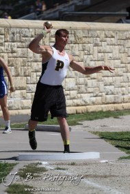 A Palco thrower competes in the shot put during the 2013 KSHSAA Class 1A Regional Track and Field competition at Lewis Field on the campus of Fort Hays State University in Hays, Kansas on May 17, 2013. (Photo: Joey Bahr, www.joeybahr.com)