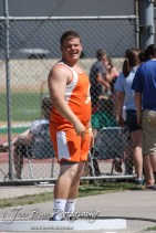 Sam Higgason of Otis-Bison reacts to a shot put throw during the 2013 KSHSAA Class 1A Regional Track and Field competition at Lewis Field on the campus of Fort Hays State University in Hays, Kansas on May 17, 2013. (Photo: Joey Bahr, www.joeybahr.com)