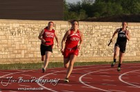 Girls turn the second corner in the first leg of the 4x100 Meter Relay during the 2013 KSHSAA Class 1A Regional Track and Field competition at Lewis Field on the campus of Fort Hays State University in Hays, Kansas on May 17, 2013. (Photo: Joey Bahr, www.joeybahr.com)