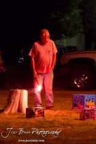 Tom Schneider waits to light a firework during the Olmitz City Fireworks Celebration at the Knights of Columbus Council #2100 Hall in Olmitz, Kansas on July 6, 2013. (Photo: Joey Bahr, www.joeybahr.com)