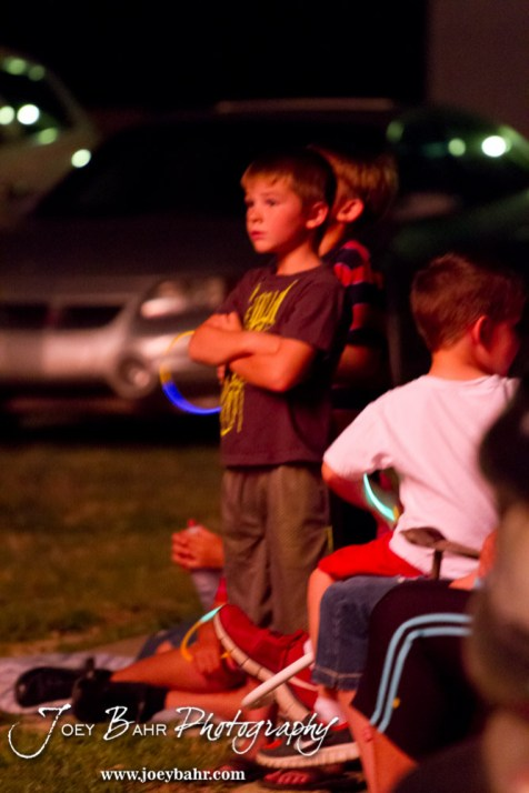 A child watches the workers lighting the fireworks during the Olmitz City Fireworks Celebration at the Knights of Columbus Council #2100 Hall in Olmitz, Kansas on July 6, 2013. (Photo: Joey Bahr, www.joeybahr.com)