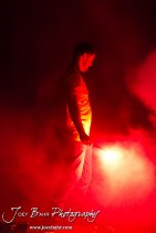 A member of the Olmitz Fire Department holds a road flare to light fireworks during the Olmitz City Fireworks Celebration at the Knights of Columbus Council #2100 Hall in Olmitz, Kansas on July 6, 2013. (Photo: Joey Bahr, www.joeybahr.com)