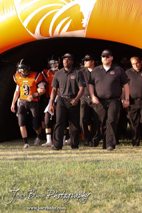 Larned Indian Head Coach AB Stokes leads his team out to the field before the Ellinwood versus Larned High School football game with the Larned Indians winning 60 to 0 at Larned High School in Larned, Kansas on September 13, 2013. (Photo: Joey Bahr, www.joeybahr.com)