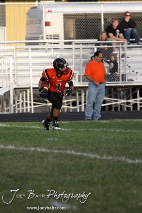 Larned Indian Evan Skelton (#1) returns the opening kick off during the Ellinwood versus Larned High School football game with the Larned Indians winning 60 to 0 at Larned High School in Larned, Kansas on September 13, 2013. (Photo: Joey Bahr, www.joeybahr.com)