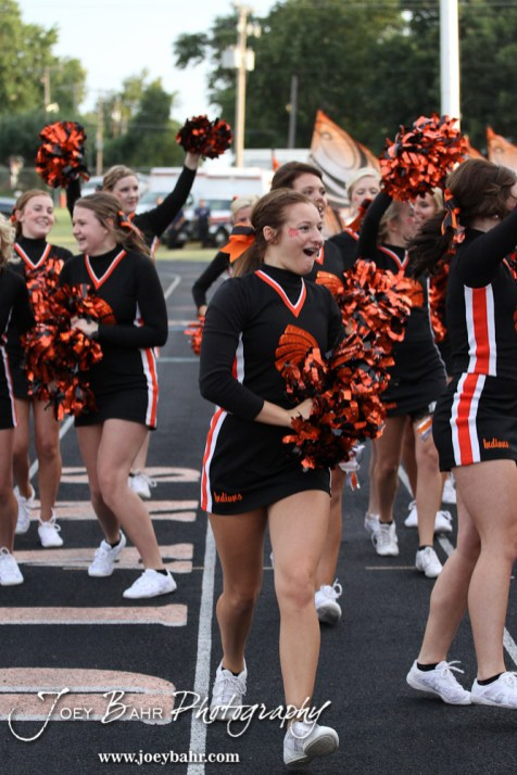A Larned Indian cheerleader celebrates a touchdown during the Ellinwood versus Larned High School football game with the Larned Indians winning 60 to 0 at Larned High School in Larned, Kansas on September 13, 2013. (Photo: Joey Bahr, www.joeybahr.com)