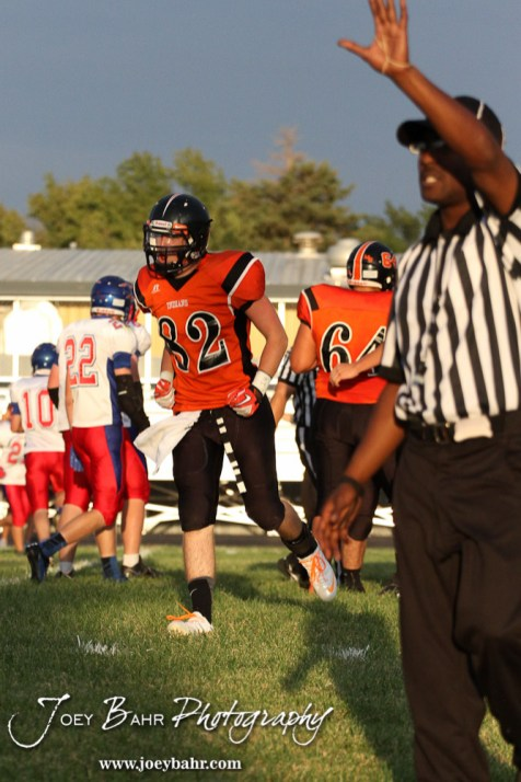 Larned Indian Tyler Stelter (#82) celebrates a good play during the Ellinwood versus Larned High School football game with the Larned Indians winning 60 to 0 at Larned High School in Larned, Kansas on September 13, 2013. (Photo: Joey Bahr, www.joeybahr.com)