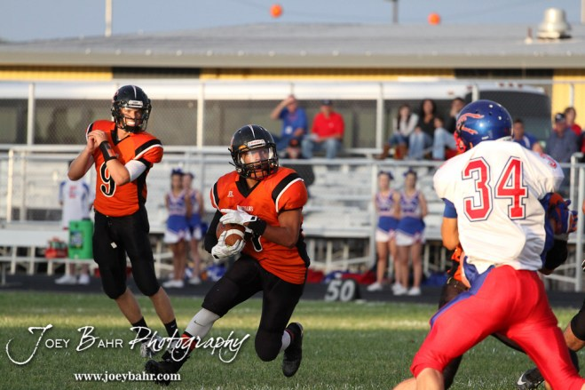 Larned Indian Jamil Shoemaker (#7) looks for a hole to run through during the Ellinwood versus Larned High School football game with the Larned Indians winning 60 to 0 at Larned High School in Larned, Kansas on September 13, 2013. (Photo: Joey Bahr, www.joeybahr.com)