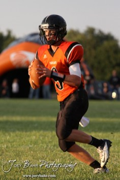 Larned Indian Easton Palmer (#9) scrambles with the ball during the Ellinwood versus Larned High School football game with the Larned Indians winning 60 to 0 at Larned High School in Larned, Kansas on September 13, 2013. (Photo: Joey Bahr, www.joeybahr.com)