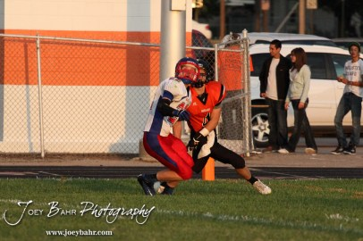 Ellinwood Eagle Tanner Swank (#22) and Larned Indian Grant Unruh (#4) watch a pass during the Ellinwood versus Larned High School football game with the Larned Indians winning 60 to 0 at Larned High School in Larned, Kansas on September 13, 2013. (Photo: Joey Bahr, www.joeybahr.com)