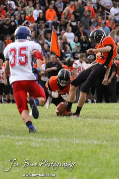 Ellinwood Eagle Gavin Vink (#35) runs to block the Point After Touchdown attempt by Larned Indian Michael Reece (#33) during the Ellinwood versus Larned High School football game with the Larned Indians winning 60 to 0 at Larned High School in Larned, Kansas on September 13, 2013. (Photo: Joey Bahr, www.joeybahr.com)