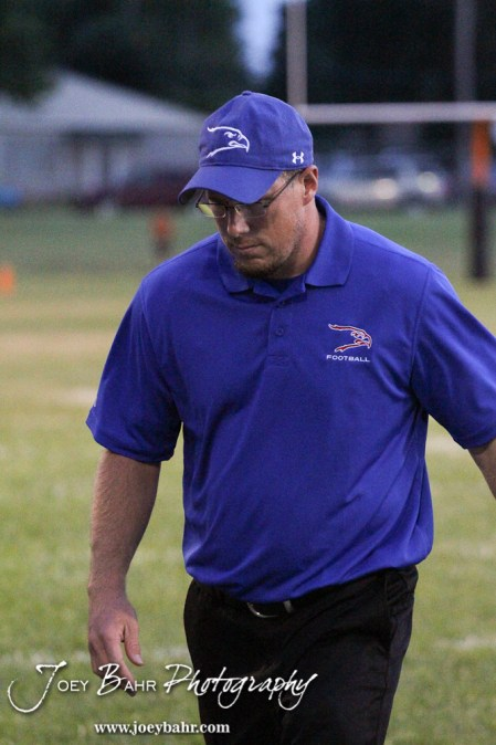 Ellinwood Eagle Head Coach Dusty Beam walks back to the sideline during the Ellinwood versus Larned High School football game with the Larned Indians winning 60 to 0 at Larned High School in Larned, Kansas on September 13, 2013. (Photo: Joey Bahr, www.joeybahr.com)