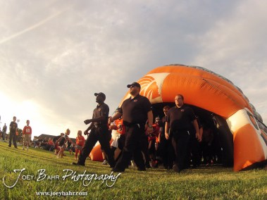 Larned Indian Head Coach AB Stokes leads his team out before the Ellinwood versus Larned High School football game with the Larned Indians winning 60 to 0 at Larned High School in Larned, Kansas on September 13, 2013. (Photo: Joey Bahr, www.joeybahr.com)