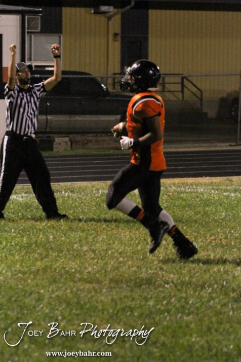 Larned Indian Jamil Shoemaker (#7) scores a touchdown during the Ellinwood versus Larned High School football game with the Larned Indians winning 60 to 0 at Larned High School in Larned, Kansas on September 13, 2013. (Photo: Joey Bahr, www.joeybahr.com)