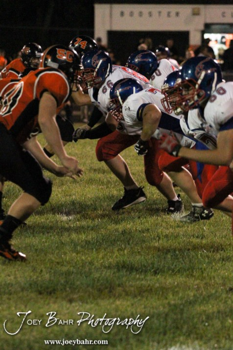 The Ellinwood Eagle offensive line launches into the Larned Indian defense during the Ellinwood versus Larned High School football game with the Larned Indians winning 60 to 0 at Larned High School in Larned, Kansas on September 13, 2013. (Photo: Joey Bahr, www.joeybahr.com)