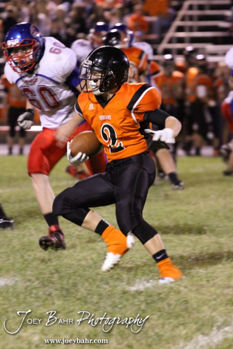 Larned Indian Gage Stude (#2) makes a cut during the Ellinwood versus Larned High School football game with the Larned Indians winning 60 to 0 at Larned High School in Larned, Kansas on September 13, 2013. (Photo: Joey Bahr, www.joeybahr.com)
