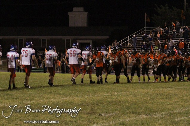 Members of the Ellinwood Eagles and Larned Indians shake hands after the Ellinwood versus Larned High School football game with the Larned Indians winning 60 to 0 at Larned High School in Larned, Kansas on September 13, 2013. (Photo: Joey Bahr, www.joeybahr.com)