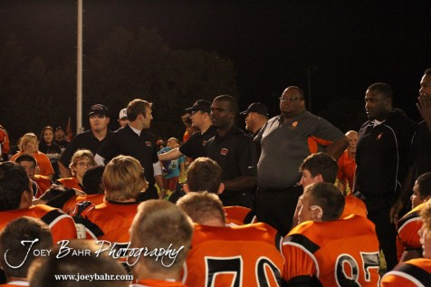 Larned Indian Head Coach AB Stokes talks to his team following the Ellinwood versus Larned High School football game with the Larned Indians winning 60 to 0 at Larned High School in Larned, Kansas on September 13, 2013. (Photo: Joey Bahr, www.joeybahr.com)