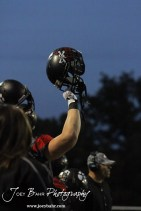 A Great Bend Panther holds up his helmet for the opening kickoff during the Salina Central versus Great Bend High School Football game with Salina Central winning 41 to 14 at Memorial Field in Great Bend, Kansas on October 25, 2013. (Photo: Joey Bahr, www.joeybahr.com)
