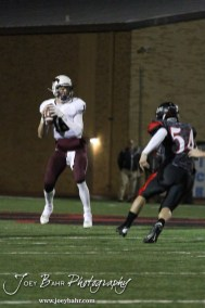 Salina Central Mustang JW Maldaner (#16) prepares to throws a pass during the Salina Central versus Great Bend High School Football game with Salina Central winning 41 to 14 at Memorial Field in Great Bend, Kansas on October 25, 2013. (Photo: Joey Bahr, www.joeybahr.com)