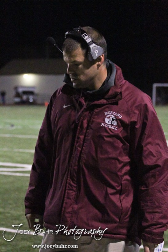 Salina Central Mustang Head Coach Michael Hall looks out to his players during the Salina Central versus Great Bend High School Football game with Salina Central winning 41 to 14 at Memorial Field in Great Bend, Kansas on October 25, 2013. (Photo: Joey Bahr, www.joeybahr.com)