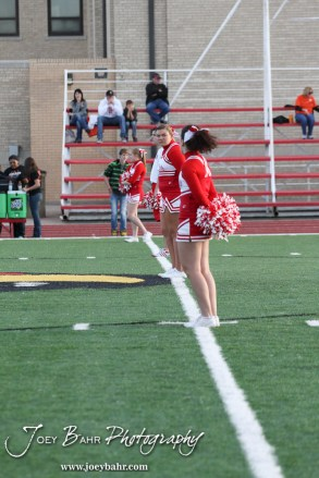 Hoisington Cheerleaders line the way for the candidates before the start of the 2013 Hoisington High School Homecoming Festivities prior to the Larned at Hoisington Football game at Elton Brown Field in Hoisington, Kansas on October 11, 2013. (Photo: Joey Bahr, www.joeybahr.com)
