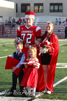 King Kagan Blackwell and Queen Deiah Curtis stand with the attendants during the 2013 Hoisington High School Homecoming Festivities prior to the Larned at Hoisington Football game at Elton Brown Field in Hoisington, Kansas on October 11, 2013. (Photo: Joey Bahr, www.joeybahr.com)