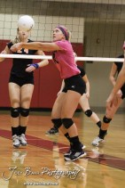 Hoisington Lady Cardinal Abi Rziha (#21) passes the ball during the Hoisington versus Smoky Valley volleyball match with Hoisington winning in two sets at Hoisington Activity Center in Hoisington, Kansas on October 22, 2013. (Photo: Joey Bahr, www.joeybahr.com)