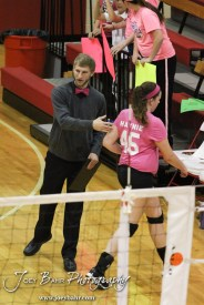 Hoisington Lady Cardinal Head Coach Jon Bingesser talks to Megan Haynie (#45) as she subs out during the Hoisington versus Smoky Valley volleyball match with Hoisington winning in two sets at Hoisington Activity Center in Hoisington, Kansas on October 22, 2013. (Photo: Joey Bahr, www.joeybahr.com)