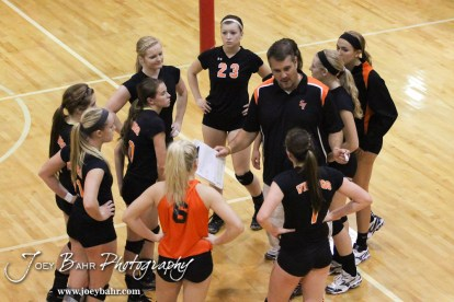 Smoky Valley Lady Viking Head Coach Doug Schneider talks to his players during a timeout from the Hoisington versus Smoky Valley volleyball match with Hoisington winning in two sets at Hoisington Activity Center in Hoisington, Kansas on October 22, 2013. (Photo: Joey Bahr, www.joeybahr.com)