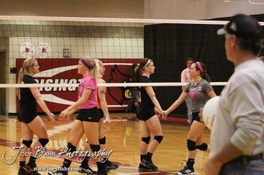 The Smoky Valley Lady Vikings and Hoisington Lady Cardinals shake hands following the Hoisington versus Smoky Valley volleyball match with Hoisington winning in two sets at Hoisington Activity Center in Hoisington, Kansas on October 22, 2013. (Photo: Joey Bahr, www.joeybahr.com)