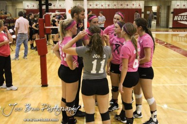 The Hoisington Lady Cardinals huddle up following the Hoisington versus Smoky Valley volleyball match with Hoisington winning in two sets at Hoisington Activity Center in Hoisington, Kansas on October 22, 2013. (Photo: Joey Bahr, www.joeybahr.com)