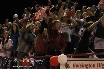Hoisington Cardinal fans cheer the first down during the Larned at Hoisington High School Football game with Hoisington winning 27 to 9 at Elton Brown Field in Hoisington, Kansas on October 11, 2013. (Photo: Joey Bahr, www.joeybahr.com)