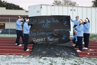 The Scott City Beaver Cheerleaders hold up a banner for the team before the KSHSAA Class 4A District 15 Football game between Scott City and Hoisington with Scott City winning 14 to 0 at Elton Brown Field in Hoisington, Kansas on October 18, 2013. (Photo: Joey Bahr, www.joeybahr.com)