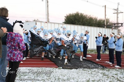 The Scott City Beavers run out onto the field prior to the KSHSAA Class 4A District 15 Football game between Scott City and Hoisington with Scott City winning 14 to 0 at Elton Brown Field in Hoisington, Kansas on October 18, 2013. (Photo: Joey Bahr, www.joeybahr.com)