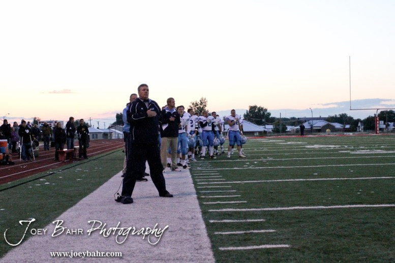 The Scott City Beavers line up for the National Anthem before the KSHSAA Class 4A District 15 Football game between Scott City and Hoisington with Scott City winning 14 to 0 at Elton Brown Field in Hoisington, Kansas on October 18, 2013. (Photo: Joey Bahr, www.joeybahr.com)