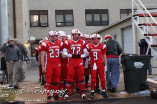 The Hoisington Cardinals lineup to run onto the field during the KSHSAA Class 4A District 15 Football game between Scott City and Hoisington with Scott City winning 14 to 0 at Elton Brown Field in Hoisington, Kansas on October 18, 2013. (Photo: Joey Bahr, www.joeybahr.com)