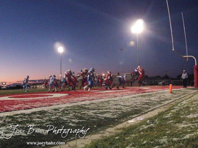 Hoisington Cardinal Chris Wright (#53) punts the ball during the KSHSAA Class 4A District 15 Football game between Scott City and Hoisington with Scott City winning 14 to 0 at Elton Brown Field in Hoisington, Kansas on October 18, 2013. (Photo: Joey Bahr, www.joeybahr.com)
