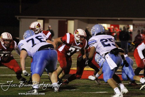 Hoisington Cardinal Landen Urban (#71) looks for a Scott City Beaver to block during the KSHSAA Class 4A District 15 Football game between Scott City and Hoisington with Scott City winning 14 to 0 at Elton Brown Field in Hoisington, Kansas on October 18, 2013. (Photo: Joey Bahr, www.joeybahr.com)