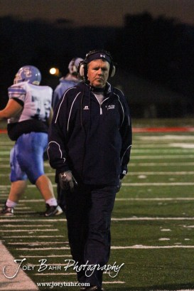 Scott City Beaver Head Coach Glenn O'Neil walks down the sideline during the KSHSAA Class 4A District 15 Football game between Scott City and Hoisington with Scott City winning 14 to 0 at Elton Brown Field in Hoisington, Kansas on October 18, 2013. (Photo: Joey Bahr, www.joeybahr.com)