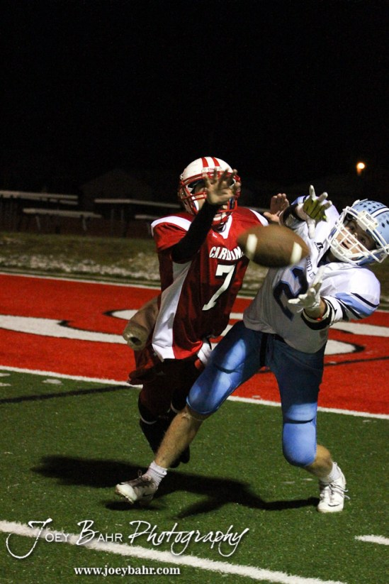 Hoisington Cardinal Taylor Richter (#7) tries to breakup a pass to Scott City Beaver Brayden Strine (#2) during the KSHSAA Class 4A District 15 Football game between Scott City and Hoisington with Scott City winning 14 to 0 at Elton Brown Field in Hoisington, Kansas on October 18, 2013. (Photo: Joey Bahr, www.joeybahr.com)
