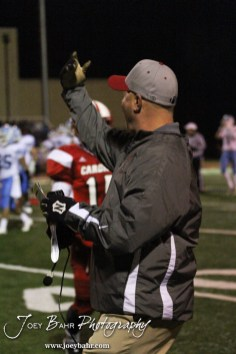 Hoisington Cardinal Head Coach Jason Ingram calls for his players to come over to the sideline during the KSHSAA Class 4A District 15 Football game between Scott City and Hoisington with Scott City winning 14 to 0 at Elton Brown Field in Hoisington, Kansas on October 18, 2013. (Photo: Joey Bahr, www.joeybahr.com)