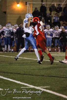 Hoisington Cardinal KC Stephens (#43) sacks Scott City Beaver Brett Meyer (#1) during the KSHSAA Class 4A District 15 Football game between Scott City and Hoisington with Scott City winning 14 to 0 at Elton Brown Field in Hoisington, Kansas on October 18, 2013. (Photo: Joey Bahr, www.joeybahr.com)