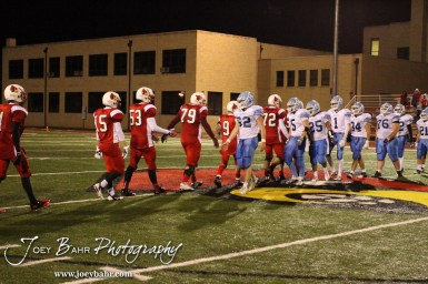 The Hoisington Cardinals and Scott City Beavers shake hands after the KSHSAA Class 4A District 15 Football game between Scott City and Hoisington with Scott City winning 14 to 0 at Elton Brown Field in Hoisington, Kansas on October 18, 2013. (Photo: Joey Bahr, www.joeybahr.com)