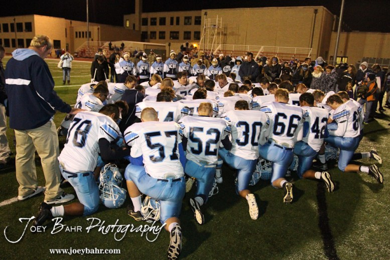The Scott City Beavers pray following the KSHSAA Class 4A District 15 Football game between Scott City and Hoisington with Scott City winning 14 to 0 at Elton Brown Field in Hoisington, Kansas on October 18, 2013. (Photo: Joey Bahr, www.joeybahr.com)