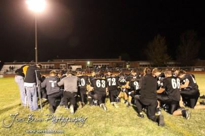 The LaCrosse Leopards pray following the Plainville versus LaCrosse KSHSAA Class 2-1A Regional Football Playoff game with LaCrosse winning 41 to 14 at Bill Schoenfelder Field in LaCrosse, Kansas on November 8, 2013. (Photo: Joey Bahr, www.joeybahr.com)