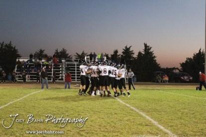 The Sylvan-Lucas Mustangs huddle up before the Sylvan-Lucas vs Otis-Bison High School football game with Otis-Bison winning 32 to 30 at Otis-Bison High School Field in Otis, Kansas on October 31, 2013. (Photo: Joey Bahr, www.joeybahr.com)