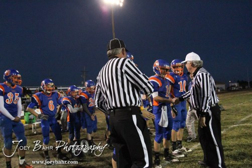 The Otis-Bison Cougar Captains meet with the Referee prior to the start of the Sylvan-Lucas vs Otis-Bison High School football game with Otis-Bison winning 32 to 30 at Otis-Bison High School Field in Otis, Kansas on October 31, 2013. (Photo: Joey Bahr, www.joeybahr.com)