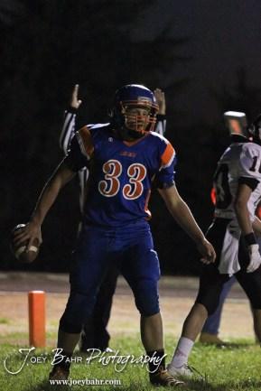 Otis-Bison Cougar Jordan Hoffman (#33) scores a touchdown during the Sylvan-Lucas vs Otis-Bison High School football game with Otis-Bison winning 32 to 30 at Otis-Bison High School Field in Otis, Kansas on October 31, 2013. (Photo: Joey Bahr, www.joeybahr.com)